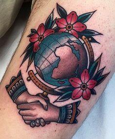 Globe hand shake old school tattoo