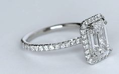 2.51`ct Emerald cut diamond diamond engagement ring, center 2.00ct H-VVS1 certified by GIA set in 18kt Halo and 0.51ct of fine diamonds. (#1496) Appraisal included. 0.52ct and 18kt setting for your di