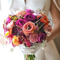Isn't this just a GORGEOUS bouquet?! It's fun...this bride was one of our very own Ida's Brides.