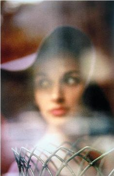 Model Carol Browne photographed by Saul Leiter.