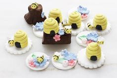 Cute and whimsical bee cupcake toppers   This listing includes: 6 fondant bee hives ( four attached with a fondant bee at the side, 1 attached to fondant log and another unattached) 5 floral cupcake toppers ( 2 of which have fondant bumble bees and 3 without). 1 fondant log with fondant flowers, fondant beehive and fondant bumble bee. 1 fondant tree stump with fondant flowers and 1 bumble bee.   Please allow 1-2 weeks before need by date to allow for creating and drying time for proper…