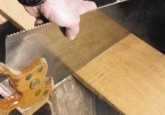 Use the reflection on your saw to line up with the board. The saw is square across the width. Now I simply draw a pencil line along the back of the saw and I have my cut line.