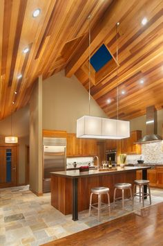 Vault your kitchen to new heights with a wood ceiling.