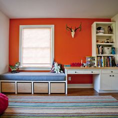 .bed under low window with built in storage.