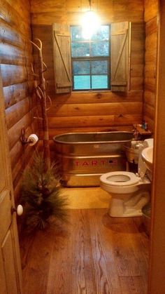 This is a great rustic cabin bathroom & even for a tiny house! Easy to Build Tiny House Plans! Almost Anyone Can Afford and be Proud of. This tiny house design-build video workshop shows how… Log Cabin Bathrooms, Tiny House Bathroom, Small Bathroom, Bathroom Ideas, Bathtub Ideas, Country Bathrooms, Rustic Cabin Bathroom, Bathroom Wall, Small Rustic Bathrooms