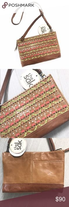 """NWT The Sak Iris 3-Way Demi Iris Clutch Crossbody Iris Leather 3 Way Demi Clutch Camel Tribal Multicolor (lime, coral, gold) Cross Body Bag. 10""""L x 7.25""""H x 2.25""""W. The Sak brand. New with tags. Pocket on back, zip pocket inside and open pocket inside. Great gift for those soon-to-be graduates! Offers welcome.🎉   Gift Statement Trendy Spring Summer Bright Colorful Wedding Graduation Birthday Purse The Sak Bags"""