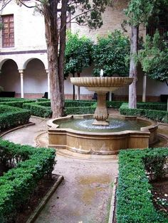 spanish garden courtyard central water feature fountain arch gallery
