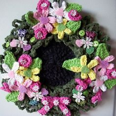 Crochet flower wreath, wall hanging, by Jerre Lollman.  Is it Spring yet? lol