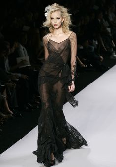 From christian dior, a dress that looks like it's been spun by a phalanx of the world's most glam spiders.