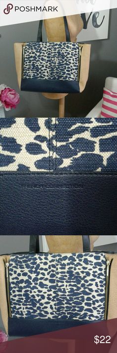 Fremch Connection navy blue leopard print handbag Ultra roomy French Connection navy blue leopard print handbag.  The base of the bag is made of navy blue (faux) leather and the sides have contrasting textured light brown (faux) leather. The straps are black in color. The leopard print portion of the bag is akin to burlap. The sides of the front of the bag each have a gold zipper, which unzips to extend the purse. Inside the bag has 2 pockets and one zipper pocket. French Connection Bags…