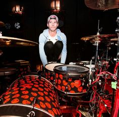 He looks like he doesn't know how not to play drums when he sits directly in front of them. The urge to play them is too big. Please let him play already. :'D