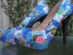 Girl guide decoupage shoes - wonder if I can do this with all the boxes of Cookies I'm about to eat?  Cookie box shoes is an awesome idea