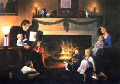Family sitting around fireplace at Christmas time