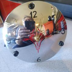 Desk clock made from used Harley Davidson derby cover. Hand pin striped. SOLD