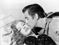 Medium publicity shot of Eleanor Parker as Lenore being kissed by Stewart Granger as Andre Moreau.
