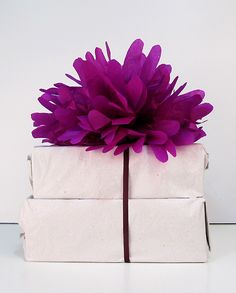 top plain wrapping paper with colorful tissue pom
