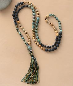 This is a gorgeous 108 mala necklace with lava stones, african turquoise, crazy lace agate beads, all genuine gemstones and a beautiful tassel end. Order now at mystictortoise.com!