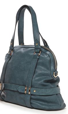 Relaxed bowler bag with detailed hardware, zipper top closure, front zipper pocket, top handles and removable shoulder strap.
