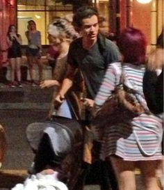 Harry Styles Pushing Baby Lux (his hair stylists baby) in her pram <3 Gahhhh AW!!!