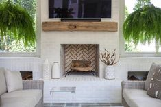 White Brick Fireplace - Design photos, ideas and inspiration. Amazing gallery of interior design and decorating ideas of White Brick Fireplace in living rooms, decks/patios, dining rooms, kitchens by elite interior designers. Outdoor Fireplace Brick, Stucco Fireplace, Painted Brick Fireplaces, Porch Fireplace, Brick Fireplace Makeover, White Fireplace, Rustic Fireplaces, Brick Patios, Fireplace Surrounds