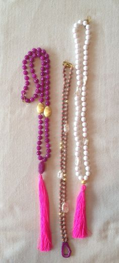 CORAL'S White bead w. mother of pearl and pink tassel- $165 Pink Jade w/ pink tassel - $215 Wood w/ Pink pendant- $165