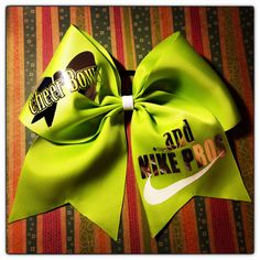 Four inch lime green ribbon with 'Cheer Bows and Nike Pros' done in reflective silver text.   www.facebook.com/MidnightBows Instagram - @MidnightBows
