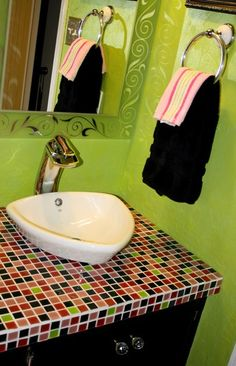 Mosaic tile countertop with vessel sink