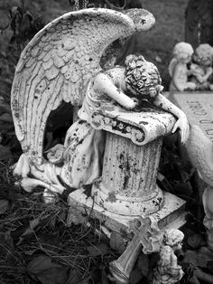 An Inconsolable Angel Lays Her Head Down on a Pedestal and Weeps Near a Grave at North Woodstock Cemetery on Route 197 in North Woodstock, CT