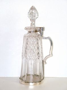 VICTORIAN BETJEMANNS DECANTER (United Kingdom) fitted with a locking collar to prevent the servants(?) from helping themselves from the contents of the Tantalus
