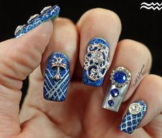 """""""Sapphire Splendor"""" stamped and jeweled nail art design featuring charms from Daily Charme."""