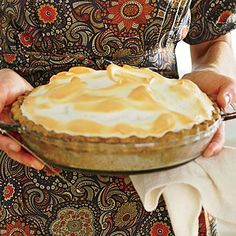 Butterscotch Meringue Pie with Pecan Crust; knock dessert out of the park this holiday season with a delicious pie piled high with whipped meringue.