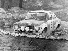 In the 1969 San Remo Rally in Italy, British drivers Roger Clark and Jim Porter navigate some awkward terrain in their Ford Escort Mk1 Twin Cam.  The pair went on to win the Circuit of Ireland Rally the following year.