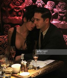 Amy Winehouse and Reg Traviss attends the launch of the Shaka Zulu bar on August 4, 2010 in London, England.