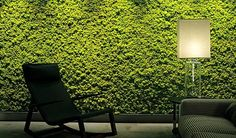 Skim lighting on this green wall by Benetti Stone.