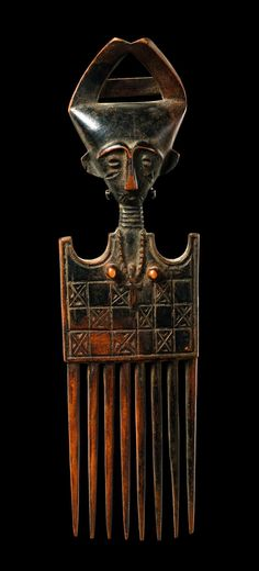 Africa | Comb from the Ashanti people of Ghana | Wood; Brown with black patina