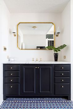 Very pretty - Like the idea of a statement mirror with sconces on each side for downstairs bath, under mount sink. Colorful tile is beautiful, but probably too busy for the space.