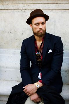 <3 The hat, glasses, pocket square, watch and red shirt make this casually worn blue suit special. Plus his fine beard.