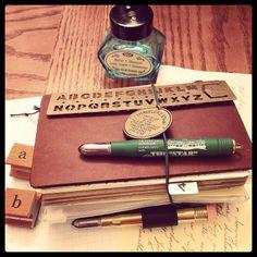 Midori Traveler's Notebook, with Midori pens & pencil sharpener by Dux