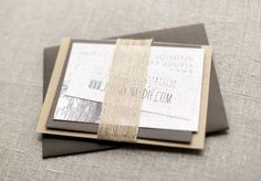copy-catting this invitation suite using cream-on-gray card stocks, banana leaf paper, a faux-bois rubber stamp and gold embossing powder.  So beautiful!