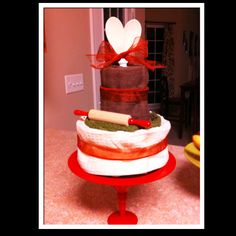 Dish towel cake with wooden spoons for a heart :) for a wedding shower