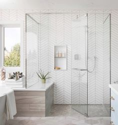 Walk-in shower with floor to ceiling white herringbone tile + glass shower doors + spa like bathroom design Bathroom Interior Design Spa Like Bathroom, Bathroom Renos, Bathroom Renovations, Bathroom Small, Bathroom Mirrors, Bathroom Showers, Bathroom Cabinets, Bathroom Lighting, Brown Bathroom