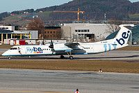 Flybe (UK) De Havilland Canada DHC-8-402Q Dash 8 G-KKEV aircraft, named ''Kevin Keegan=an English football player 1951'', with the sticker of the player on the airframe, skating at Austria Salzburg W.A.Mozart International Airport. 29/12/2012.