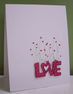 Simple and sweet blooming hearts for Valentine's Day. It's easy to cut out the LOVE letters and pop them up for this handmade card.