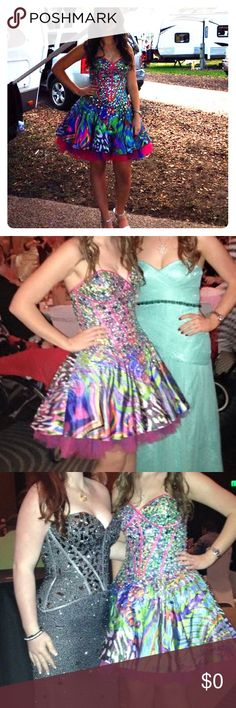 """✨SALE✨Multicolor Jovani dress It has a sequin and rhinestone top and it has also been taken in its a 6 and fits like a 3 and had pads put in so you don't have to wear a bra and there is a stain on the inside of the dress there's a picture above. The Bust Size is 16"""" The Waist Size is 13"""" and The Length is 25"""" Jovani Dresses Prom"""