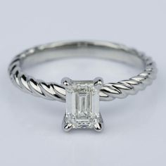 This Twisted Rope Solitaire Emerald Diamond Engagement Ring in Palladium is gorgeous!