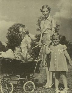 Queen Ingrid of Denmark, nee Princess Ingrid of Sweden, with her 3 daughters: Princess Margrethe, left, later Queen Margrethe II of Denmark, Princess Benedikte, right, and baby Princess Anne-Marie, later Queen of Greece.