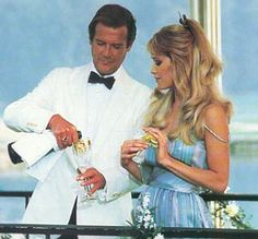 Roger Moore as James Bond and Tanya Roberts as Stacey Sutton in A View To A Kill 1985 James Bond Girls, James Bond Movies, Roger Moore, French Films, Thing 1, Good Movies, Actors, Celebrities, Bollinger Champagne