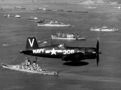 A U.S. Navy F4U-4B Corsair of fighter squadron VF-113 Stingers flies over U.S. ships at Inchon, Korea, Sept. 15, 1950. VF-113 was assigned to Carrier Air Group Eleven (CVG-11) aboard the aircraft carrier USS Philippine Sea (CV 47). The battleship USS Missouri (BB 63) is visible below the Corsair. DoD photo