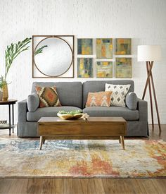 Mid-Century Mod  It's the epitome of understated cool.  Addilyn Sofa / Conrad Collection / Brooklyn Floor Lamp / Raindrops Wall Art / Clayton Wall Mirror / Navarro Kilim Pillow / Tribal Accent Lumbar Pillow / Natural Diamond Pillow