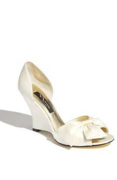 wedding shoes? I like the wedge because its an outdoor wedding... easier to walk in on grass